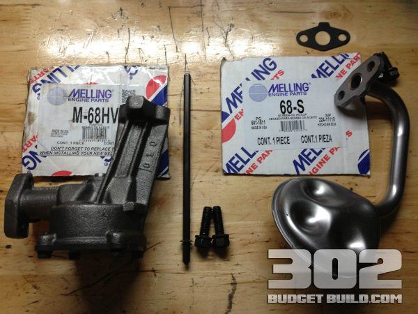 Melling oil pump and screen with part numbers to be installed on the small block ford 302